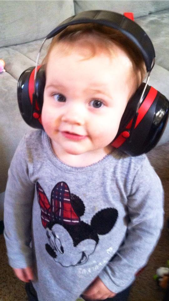 Ella feeling very proud in her Daddy's headphones.  OMG, she is so cute!