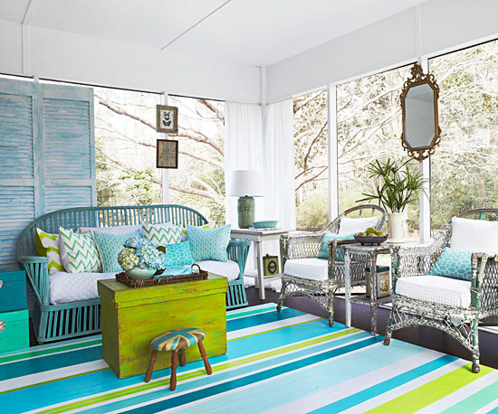 Cool shades of blue and green in this room courtesy of BHG