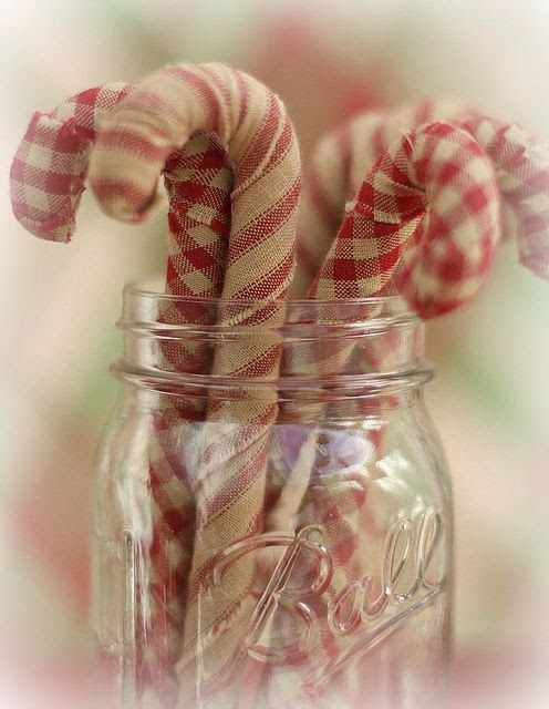 To get this look from Decorators Best simply wrap candy cane shaped tin foil in your favorite holiday fabric and glue the ends.  Too cute for words!