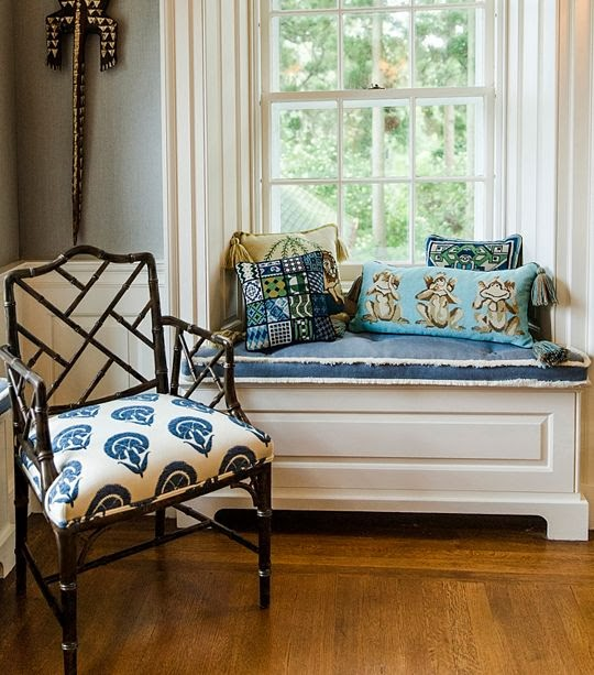 A random selection of pillows casually tossed onto a window seat.  photo from Tory Burch