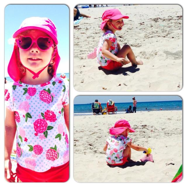 ella in pink building sandcastles july 2014