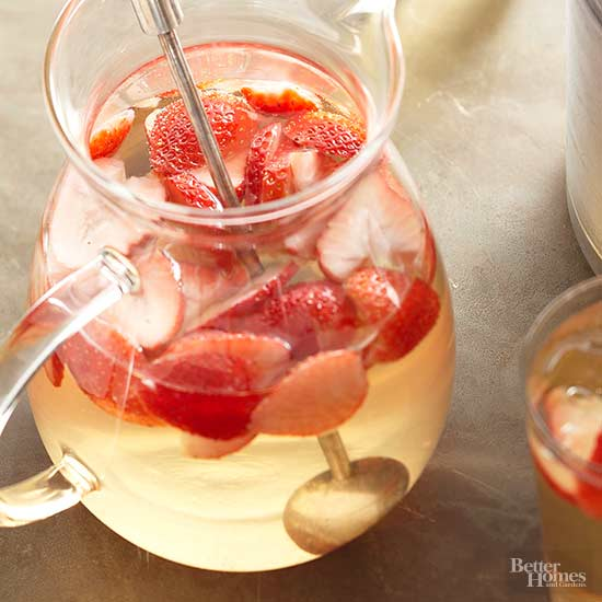 pitcher of strawberries for summer sangria from bhg