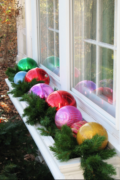christmas-window-box-from-house-beautiful-with-fake-ornaments