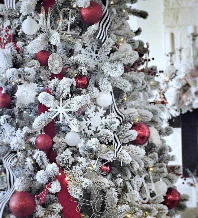christmas-tree-flocked-with-red-ornaments-and-black-and-white-striped-ribbon-from-home-bunch
