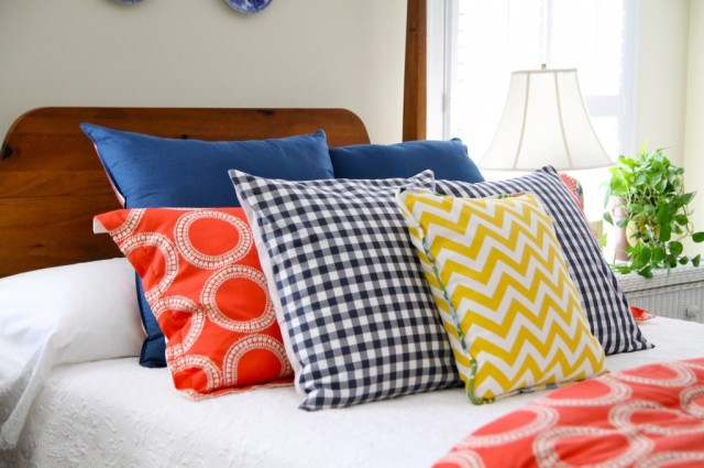 design fabric pattern mix with colorful pillows on bed from the 2 seasons blog
