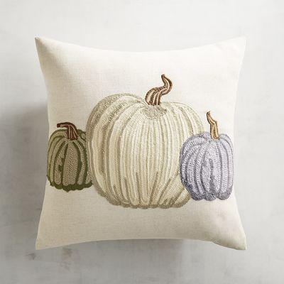 pumpkin pillow with blue and green pumpkins from pier 1