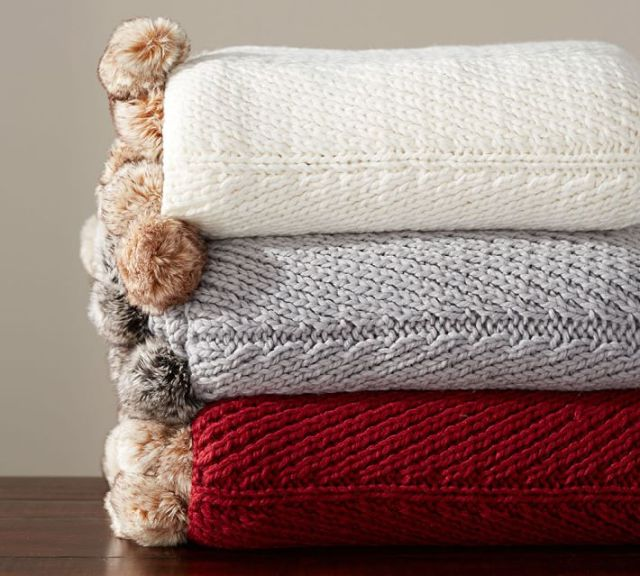 pom pom throws from pottery barn